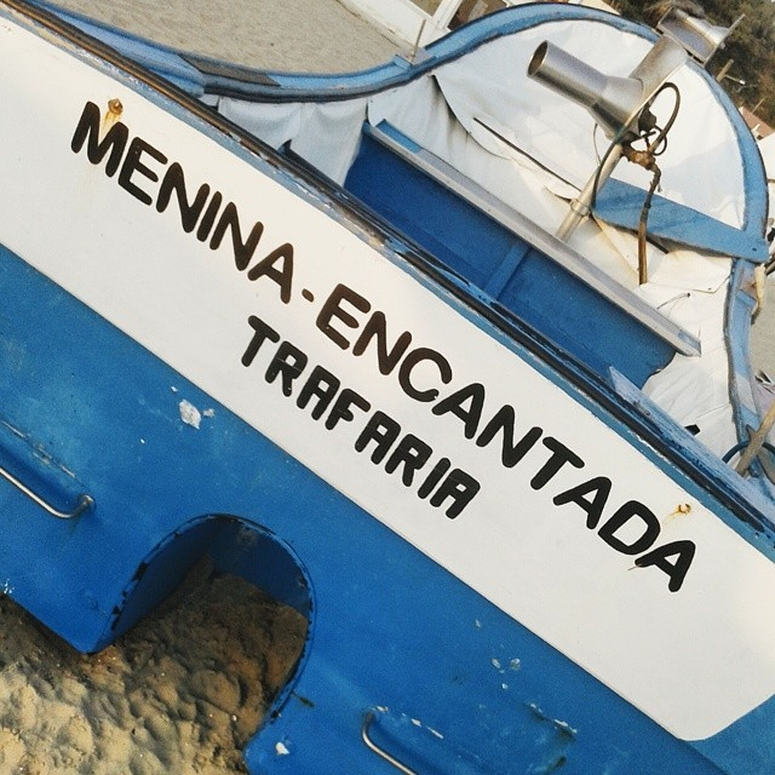 text, transportation, mode of transport, western script, communication, high angle view, blue, part of, nautical vessel, water, cropped, day, close-up, no people, guidance, travel, number, outdoors, boat, information sign