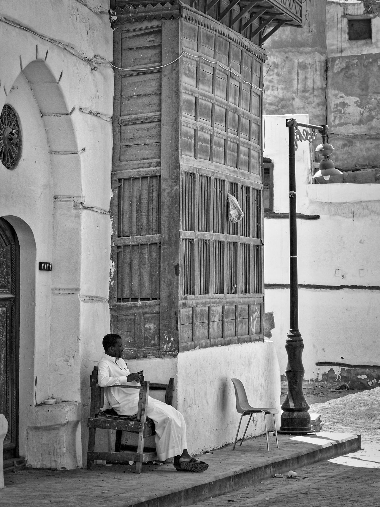 Arab Arabic Arabic Architecture Arabic Style Architecture Built Structure City Life City Street Cityscape EyeEm Best Shots - Black + White Jeddah Old But Awesome Old House Old Jeddah Old Town People People And Places People Photography Saudi Arabia Simple Moment Sitting Street Photography Streetphotography Urban Lifestyle Worn Down Buildings