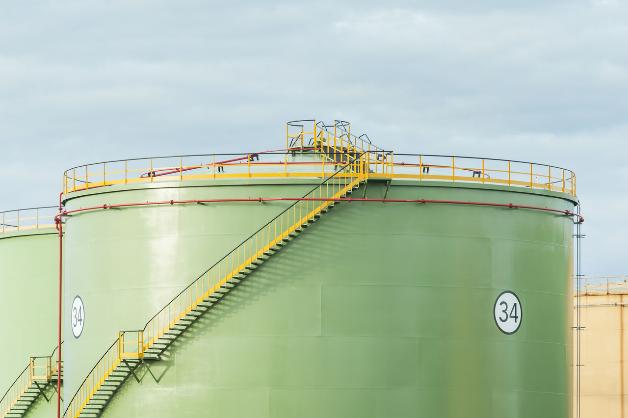 Industrial Storage Tanks. Oil tank with stair Chemical Day Energy Equipment Factory Industrial Industry No People Oil Refinery Outdoors Petrochemical Plant Power Refinery Silos Sky Staircase Steps Storage Tanks Warehouse