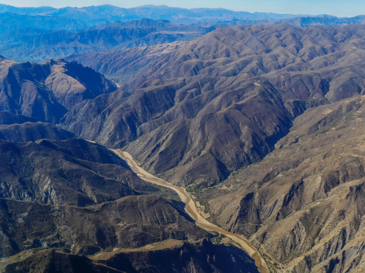 Canyon flying over Peru Beauty In Nature Nature Landscape Scenics Mountain Outdoors Traveling Landscape_Collection Eye4photography  EyeEm Nature Lover Nature_collection Landscapes Travel Flying High Aerial View Mountains Mountain Range Canyon Peru Travel Destinations On The Road From An Airplane Window Flying