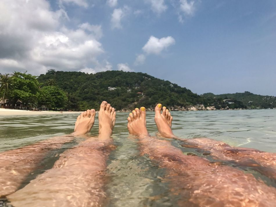 Barefoot Relaxation Water Human Foot Human Leg Women Only Friendship Togetherness Enjoying Life Sea Swimming Travel Destinations Personal Perspective Leisure Activity Sky Nature Beauty In Nature Vacations Scenics Outdoors Real People Clear Water Low Section Close-up Human Body Part