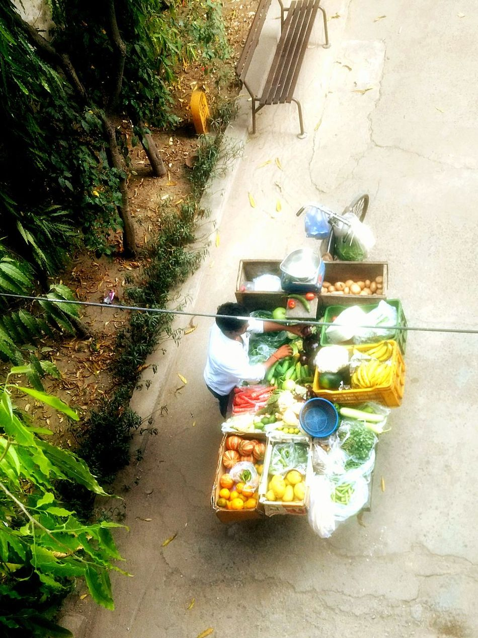 Colured vegetable vendor High Angle View No People Day Outdoors Tree