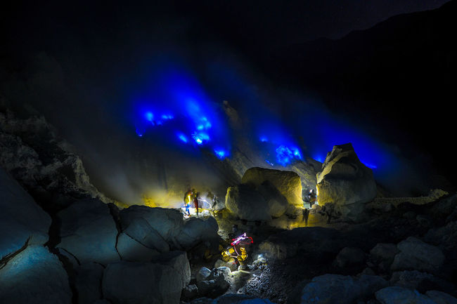 Ijen Blue Fire Beauty In Nature Blue Boulder - Rock Environment Eroded Extreme Terrain Famous Place Geology Illuminated Majestic Natural Landmark Nature Night Non-urban Scene Physical Geography Rock Rock - Object Rock Formation Scenics Sky Tourism Tranquil Scene Tranquility Travel Destinations Vacations