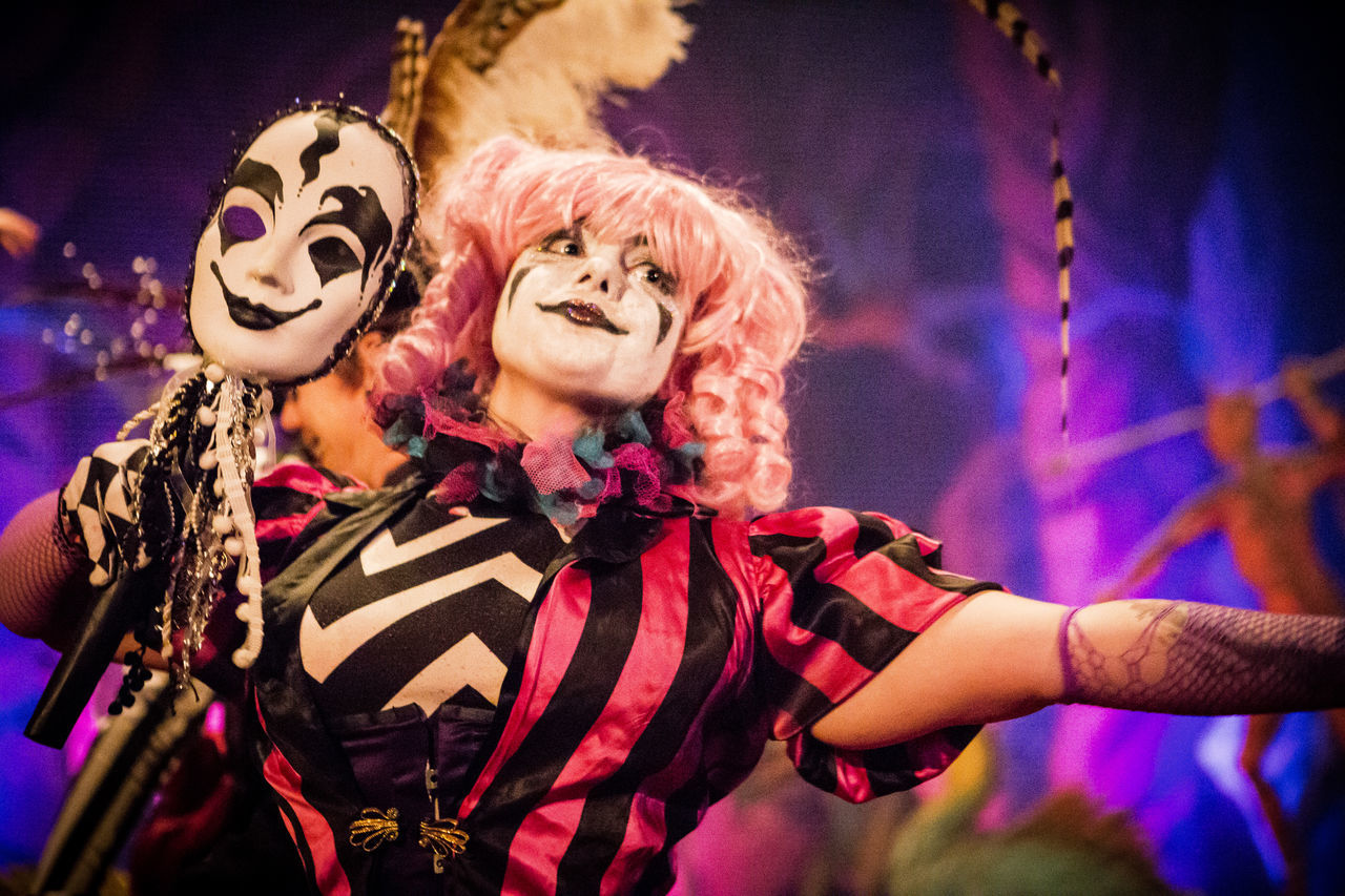 Colors Of Carnival San Francisco Young Adult Performance Performer  Clown Cirque Circus Edwardian Ball Mardi Gras Pink Wig Kabuki Makeup Dramatic Light Dramatic Lighting Portrait Portrait Of A Woman Waist Up Masquerade Mask Masque Pastel Power Up Close Street Photography The Portraitist - 2016 EyeEm Awards The Street Photographer - 2016 EyeEm Awards