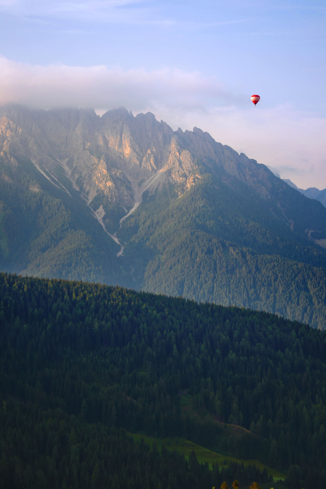 Adventure Beauty In Nature Cloud - Sky Day Flying Hot-air Balloon Idyllic Landscape Lanscapes With Whitewall Mid-air Mountain Mountain Range Nature Non-urban Scene Outdoors Remote Scenics Sky Tranquil Scene Tranquility Transportation Travel