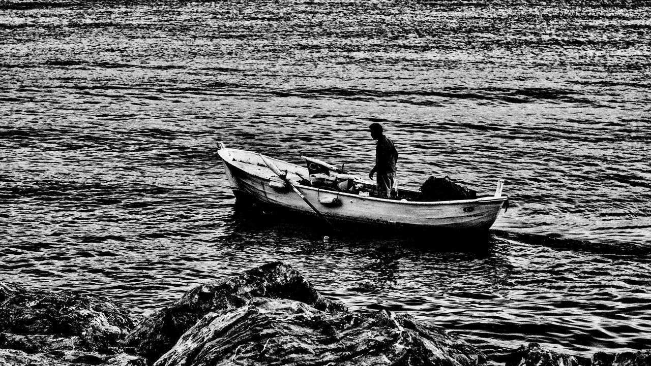 nautical vessel, water, boat, transportation, mode of transport, outdoors, day, real people, one person, nature, sea, men, moored, people