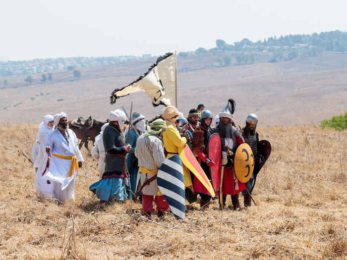 Tiberias, Israel, July 01, 2017 : Participants in the reconstruction of Horns of Hattin battle in 1187 Dressed in the costumes of Saladin's soldiers stand in anticipation of an attack near Tiberias, Israel Battle Cross Crusaders Field Fire Guy De Lusignan Hattin Heat Heritage History Horn Horseman Infantry Israel Jerusalem KINGDOM Knight  Muslims Palestine Religion Saladin Templars Victory War Weapons