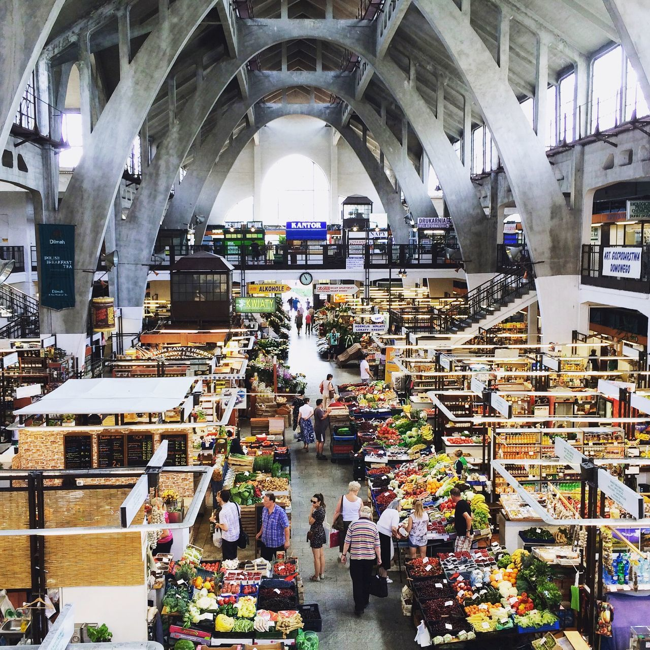 Hala Targowa. Wrocław, Poland. Photo by Tom Bland. Retail  Market Stall Market Indoors  People Bazaar Urban IPhone IPhoneography Wroclaw, Poland Wroclaw Wrocław City Street Scenes Street Scene Architecture Europe The City Light Hala Targowa Indoor Market Covered Market Shopping ♡ European Capital Of Culture Brutalism Brutalist Architecture