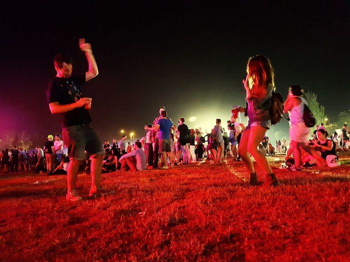 Young people having fun at night music festival. Concert Live Music Festival Young Couple Fun Night Lights First Eyeem Photo