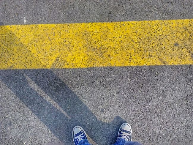 Day Outdoor Outdoor Photography Yellow Line Blue Jeans Black Sneakers Road Do Not Cross Do NOT Cross The Line Cross The Line