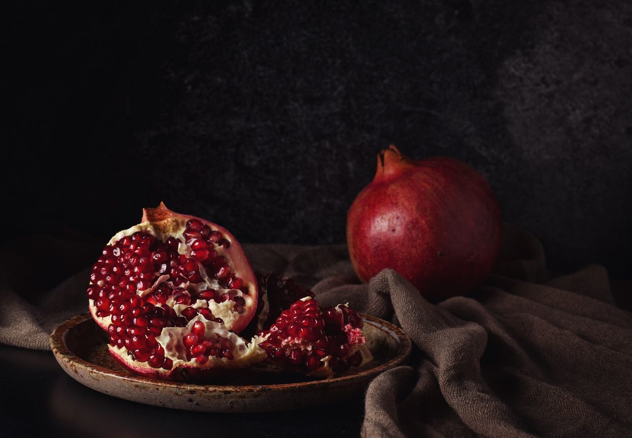 When it's cold outside... Fruit Healthy Eating Freshness Food Food And Drink Red Close-up Table Plate No People Black Background Pomegranate Ready-to-eat Day