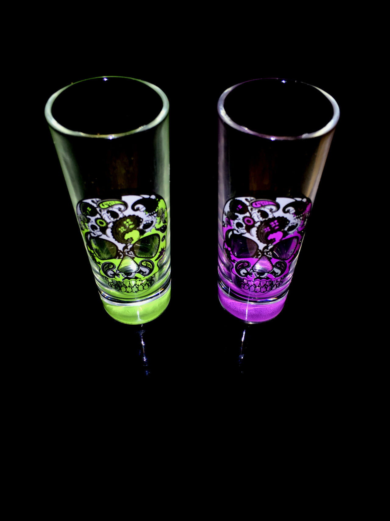 Day of the Dead shot glasses reflecting on black background Black Black Backdrop Black Background Cinco De Mayo Colorful Dark Dark Darkness Darkness And Light Day Of The Dead Fesitival Green IPhoneography Iphonephotography Light And Dark Lowkey  Minimalism Minimalist Minimalistic Multi Colored Purple Shot Glass Shot Glasses