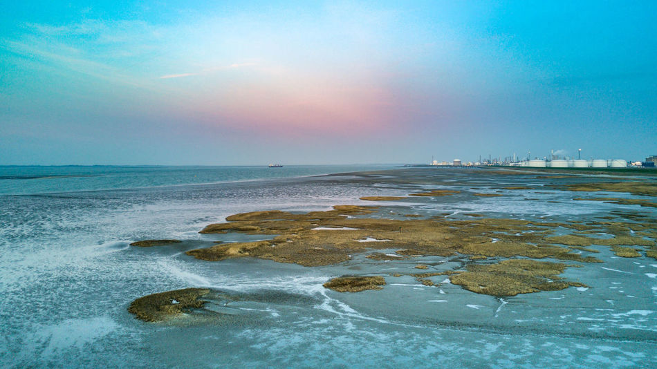 16x9 Beach Beauty In Nature Blue Blue Sea Coastline Cold Temperature Day Horizon Over Water Industry Landscape Nature Nature No People Outdoors Scenics Sea Sky Sunset Tranquil Scene Tranquility Water Wave