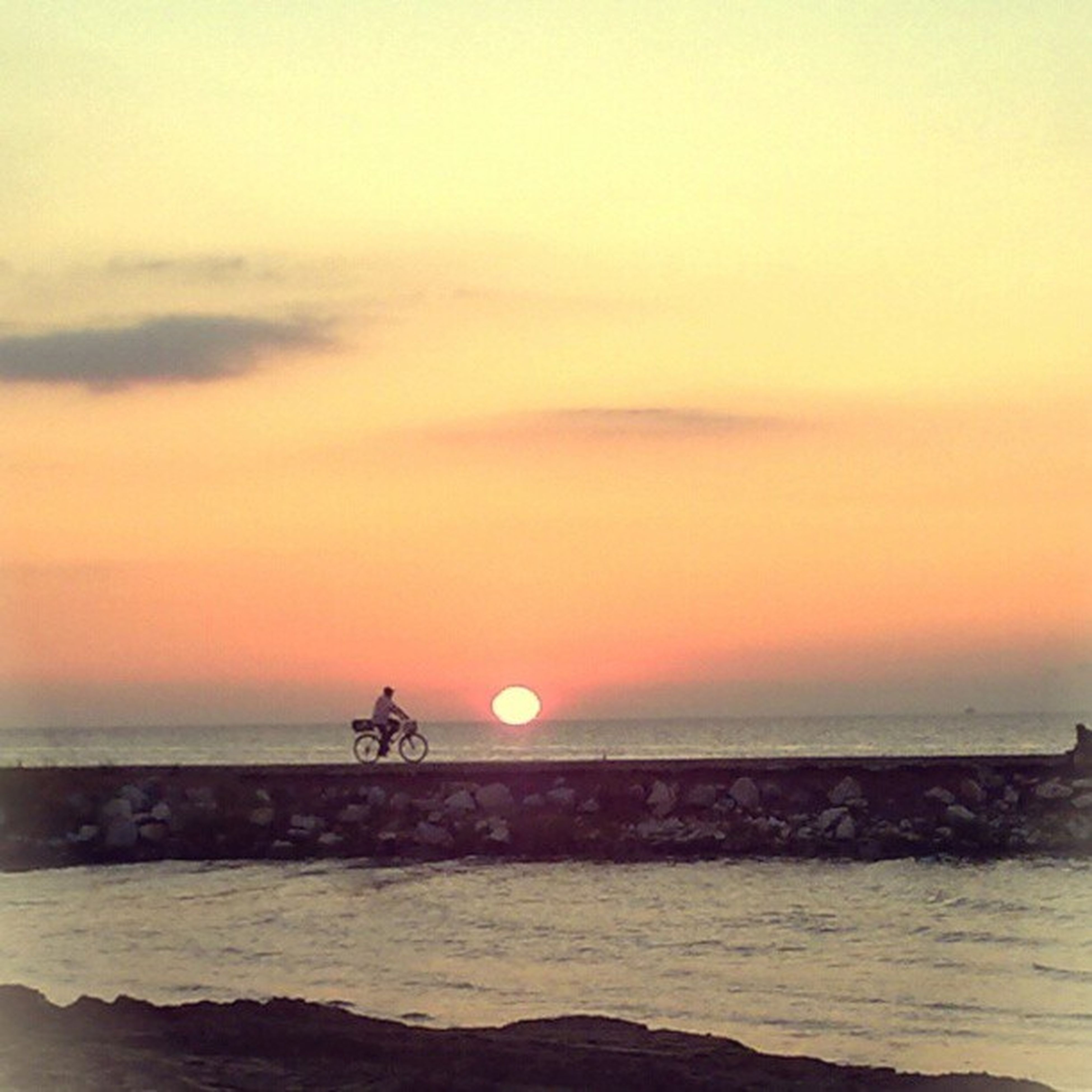 sunset, sea, horizon over water, water, orange color, scenics, sun, beauty in nature, sky, beach, tranquil scene, silhouette, leisure activity, tranquility, lifestyles, idyllic, men, nature
