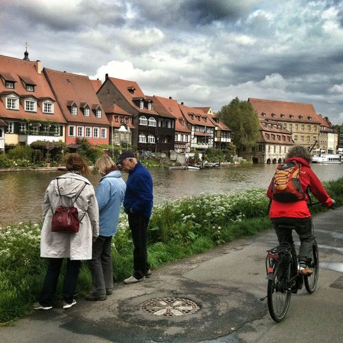 Taking Photos Tourists watching and cycling at the River Regnitz