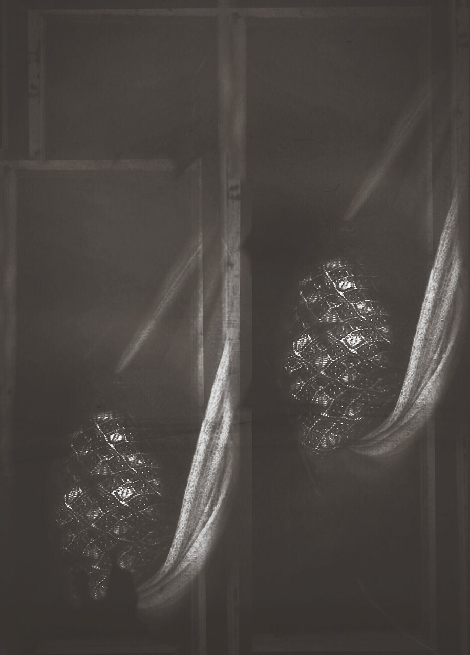 Close-up of curtains in the dark