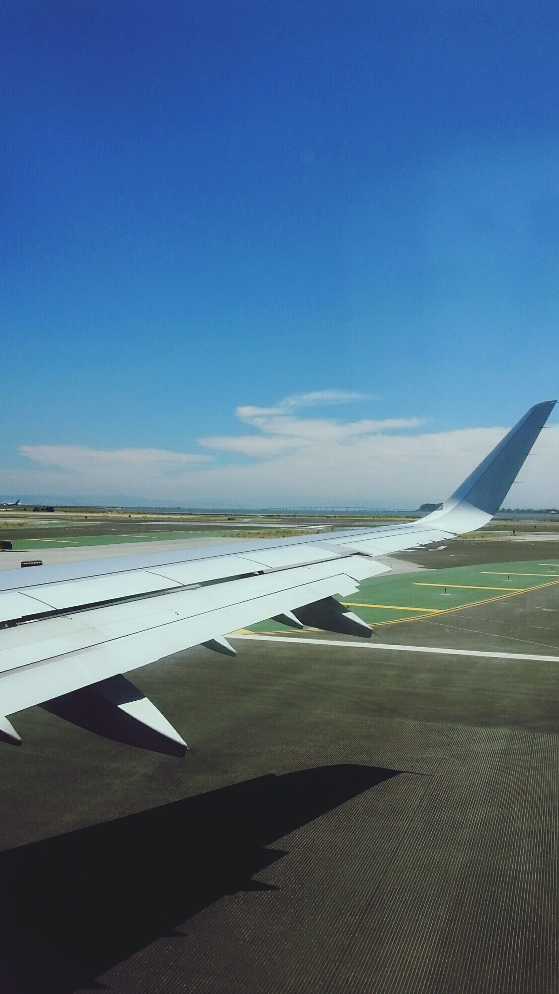 blue, copy space, sky, flying, clear sky, nature, water, scenics, tranquil scene, sea, tranquility, beauty in nature, no people, day, outdoors, transportation, airplane, part of, cropped, idyllic