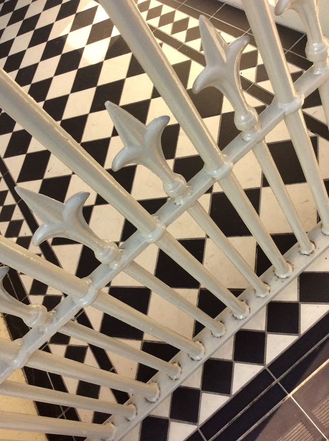 Uk Victorian iron gate Victorian Tiles black and white tiles Evening Sun shadow Grout Home