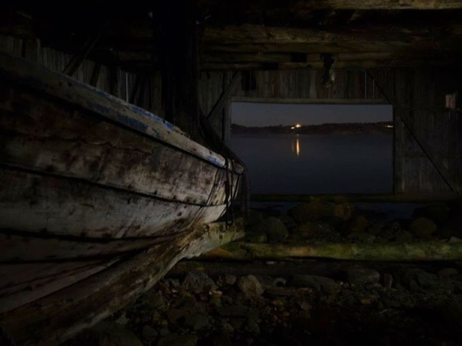An old boats dream.... Cellar Indoors  Cave Dark Illuminated Lighting Equipment Wine Cellar Built Structure No People Night Dream Oldboat Boat Boathouse EyeEm Best Shots EyeEm Nature Lover Nature Photography Scenery Shots Longing Longing To Go Back...