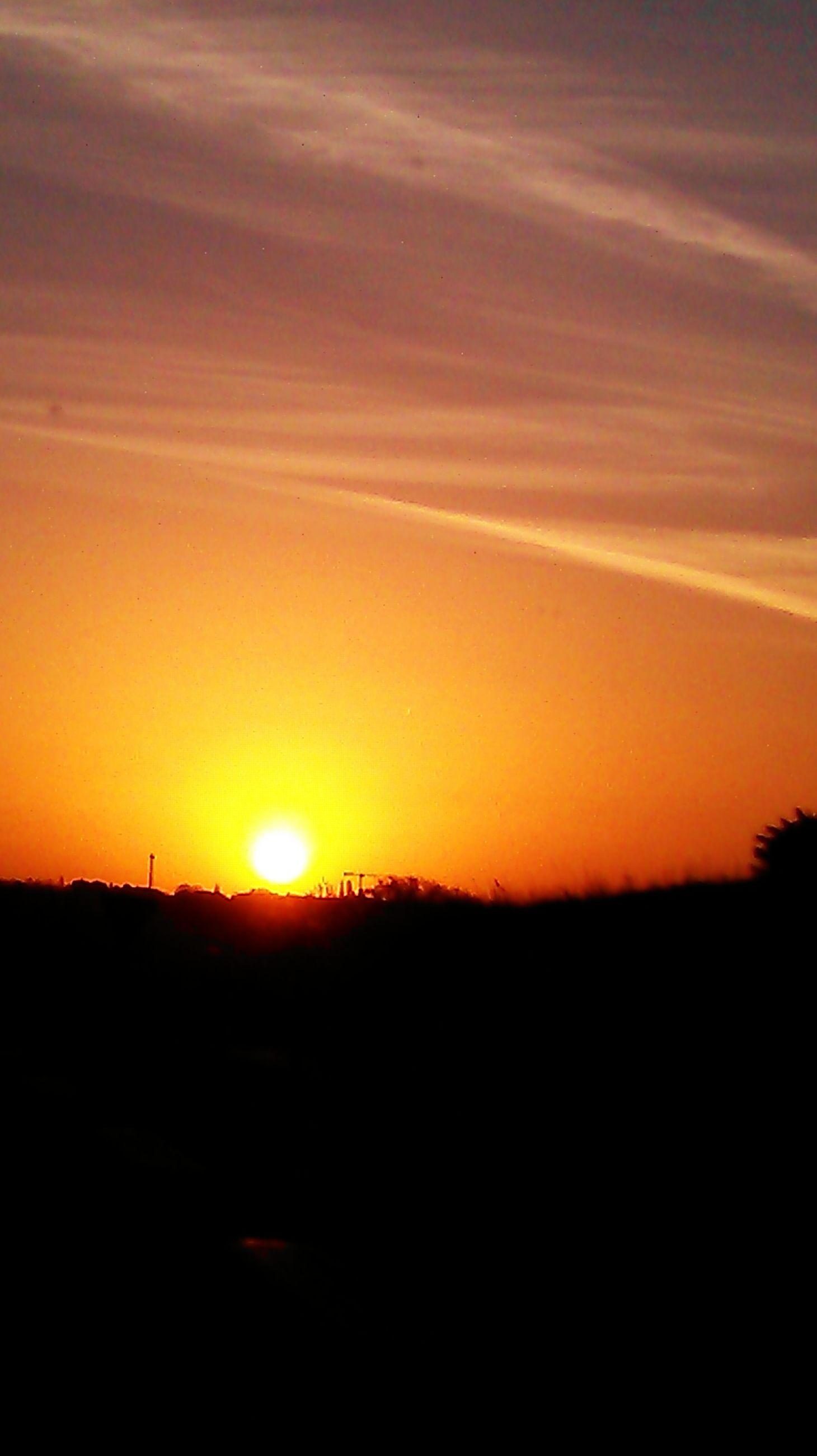 sunset, silhouette, orange color, sun, scenics, tranquil scene, beauty in nature, tranquility, landscape, sky, idyllic, nature, copy space, sunlight, horizon over land, dark, outdoors, dramatic sky, field, majestic