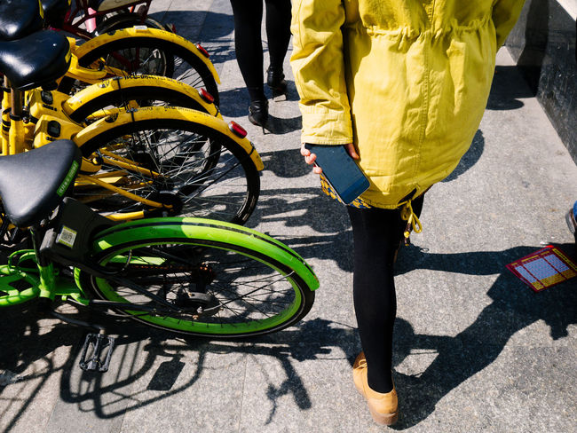 Adult Bicycle Day High Angle View Human Leg Land Vehicle Lifestyles Low Section Men Mode Of Transport One Person Outdoors People Real People Shadow Standing Street Sunlight Transportation Walking Yellow