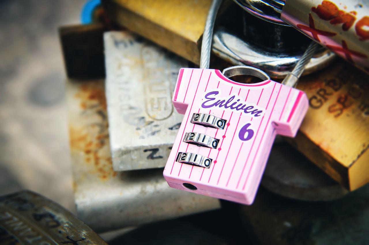 Close-up Hanging Hope Love Love Lock Luck Malta Metal Multi Colored No People Number Padlock Pink Rust Rusty Text Western Script