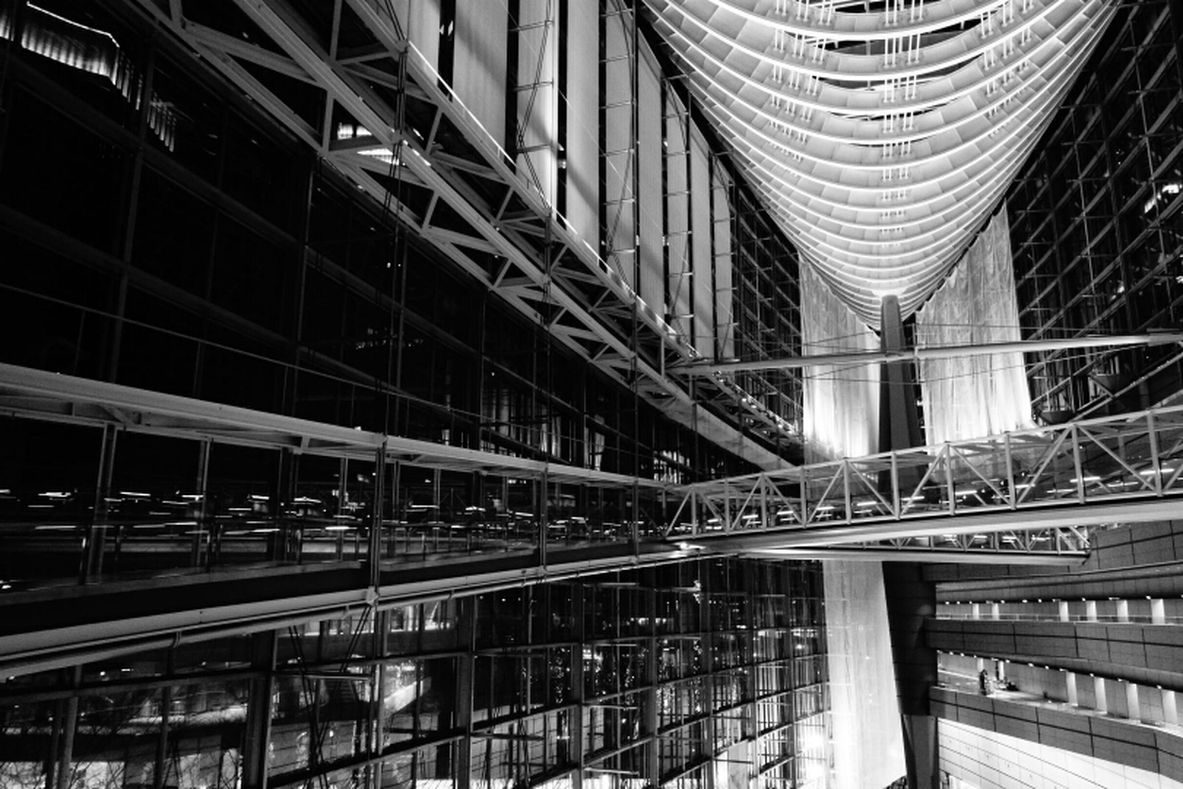 architecture, built structure, building exterior, low angle view, building, railing, city, modern, indoors, architectural feature, ceiling, window, no people, connection, metal, architectural column, bridge - man made structure, day, incidental people, staircase