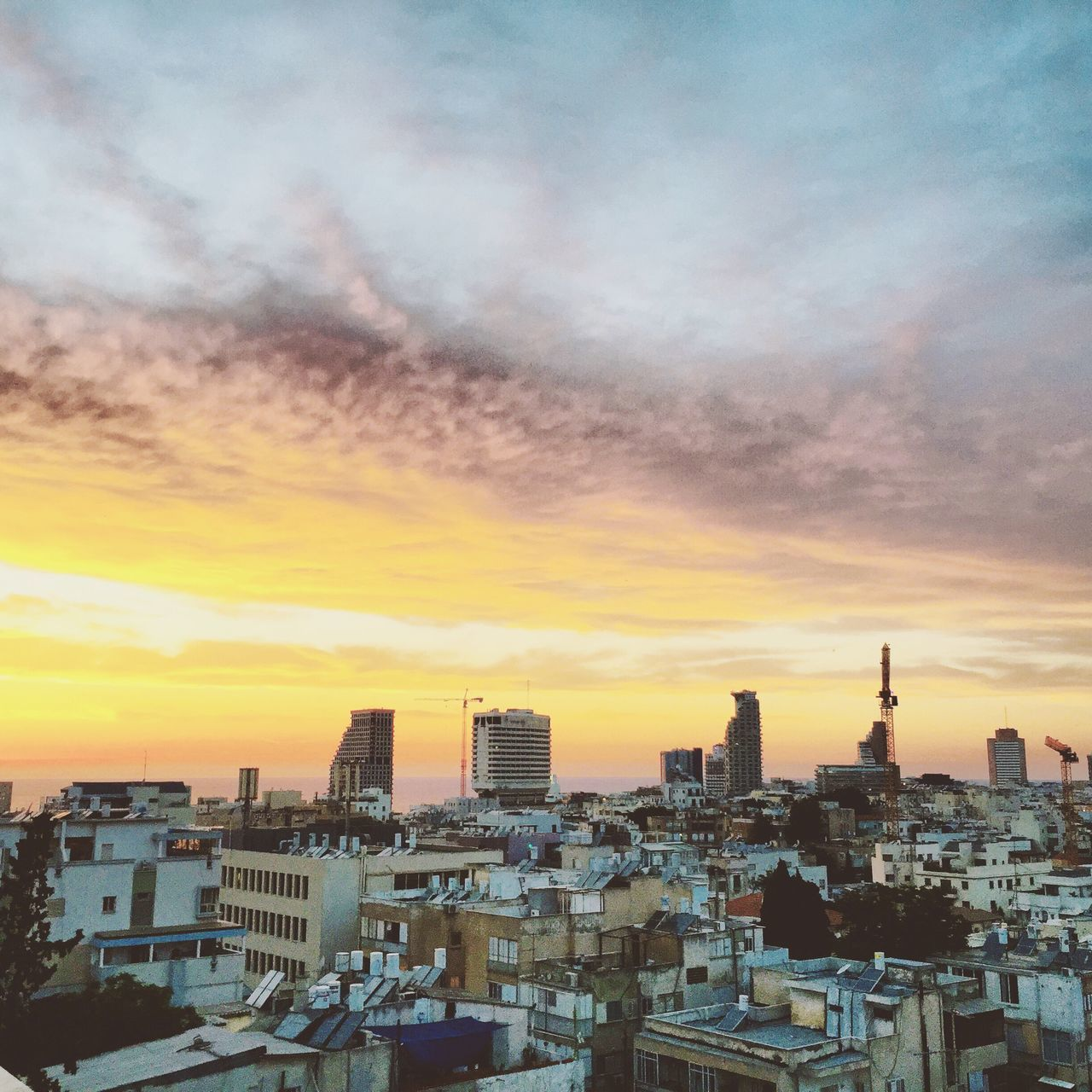 architecture, building exterior, sunset, built structure, cityscape, city, sky, no people, residential building, skyscraper, cloud - sky, outdoors, modern, travel destinations, urban skyline, nature, day
