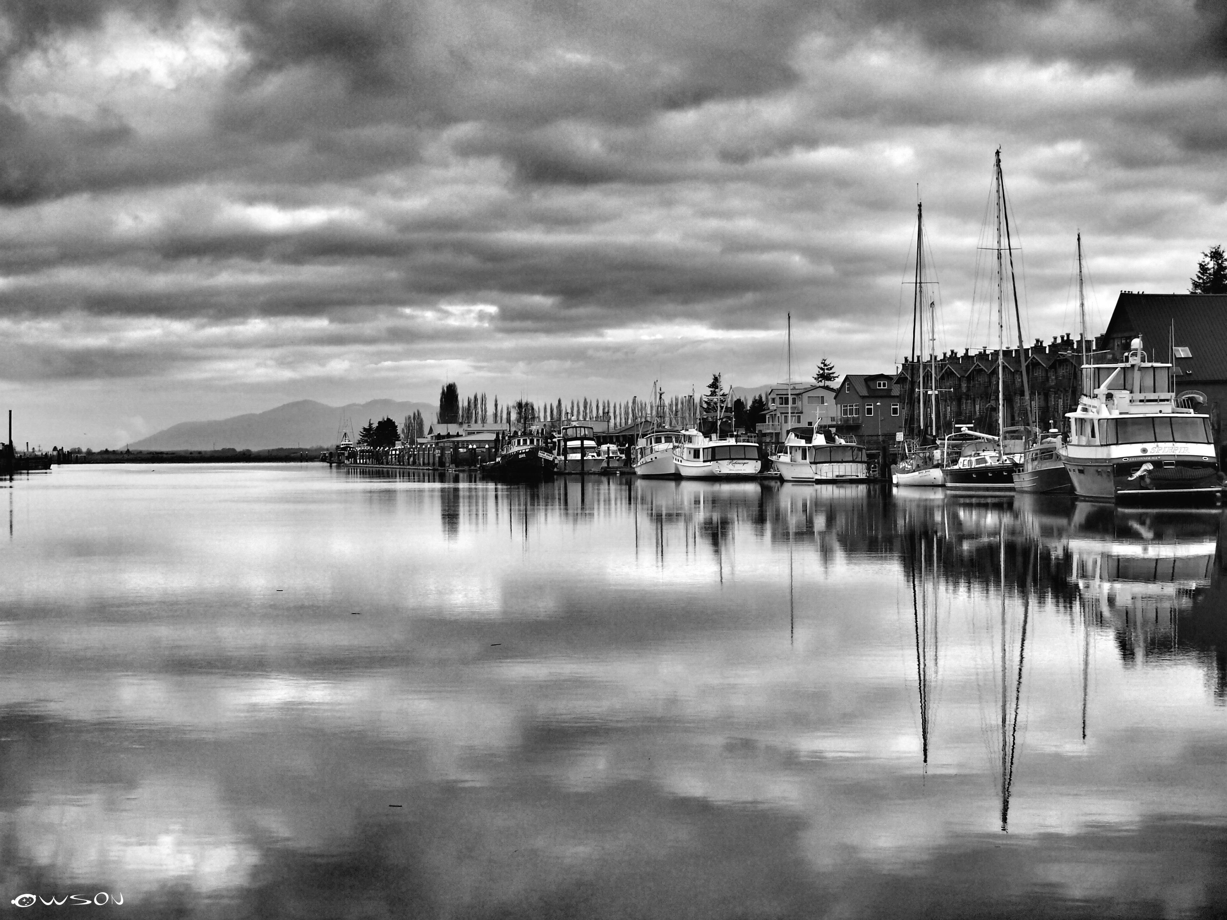 water, reflection, sky, waterfront, cloud - sky, building exterior, moored, nautical vessel, transportation, architecture, built structure, cloudy, harbor, lake, mode of transport, boat, cloud, river, city, weather