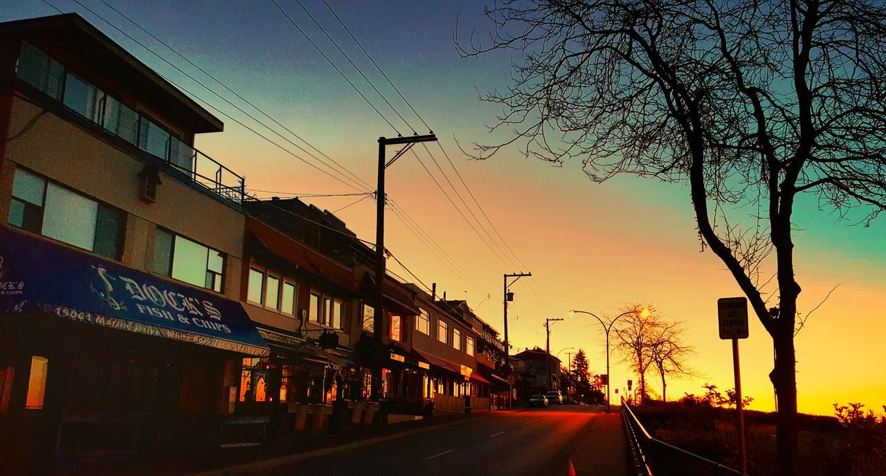 road, transportation, sunset, sky, cable, street, the way forward, outdoors, built structure, no people, architecture, electricity pylon, bare tree, city, building exterior, tree, nature, day
