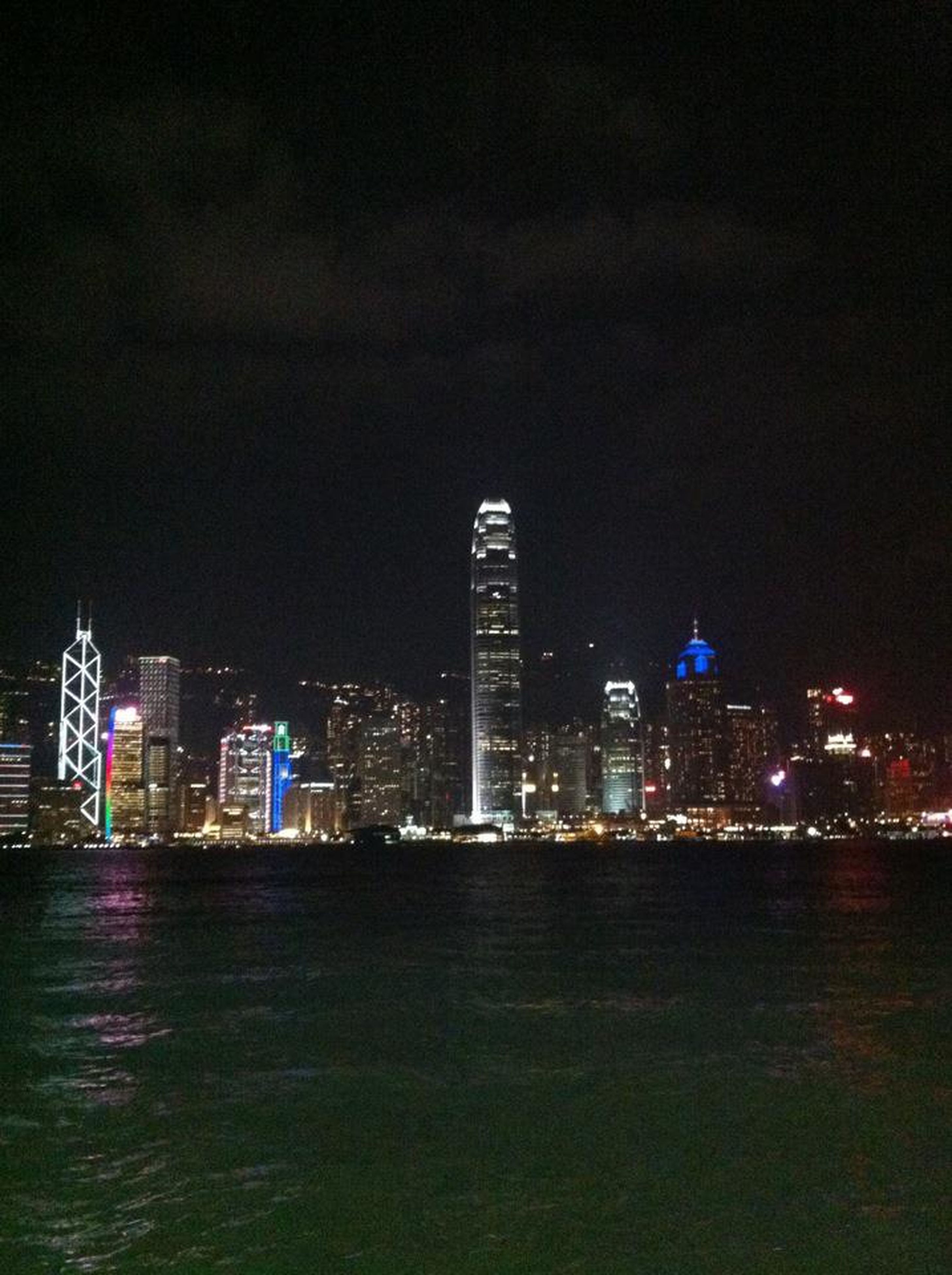 illuminated, night, city, building exterior, architecture, skyscraper, built structure, cityscape, modern, urban skyline, waterfront, tall - high, tower, water, office building, sky, sea, financial district, river, capital cities