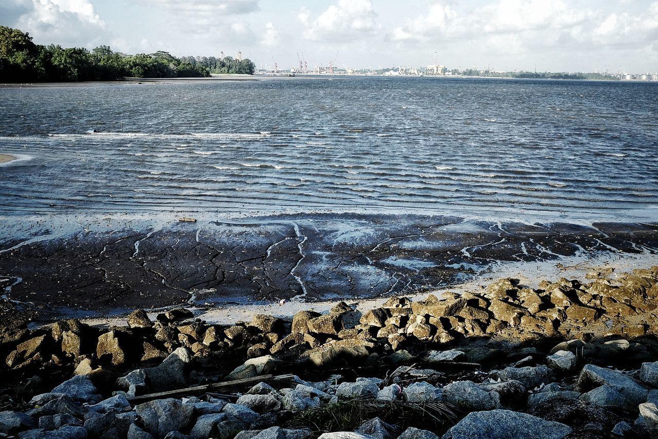Sea shore. Water Sky Nature Outdoors Beauty In Nature Sea Sea Sand Rocks Streetphotography Singapore Refinery
