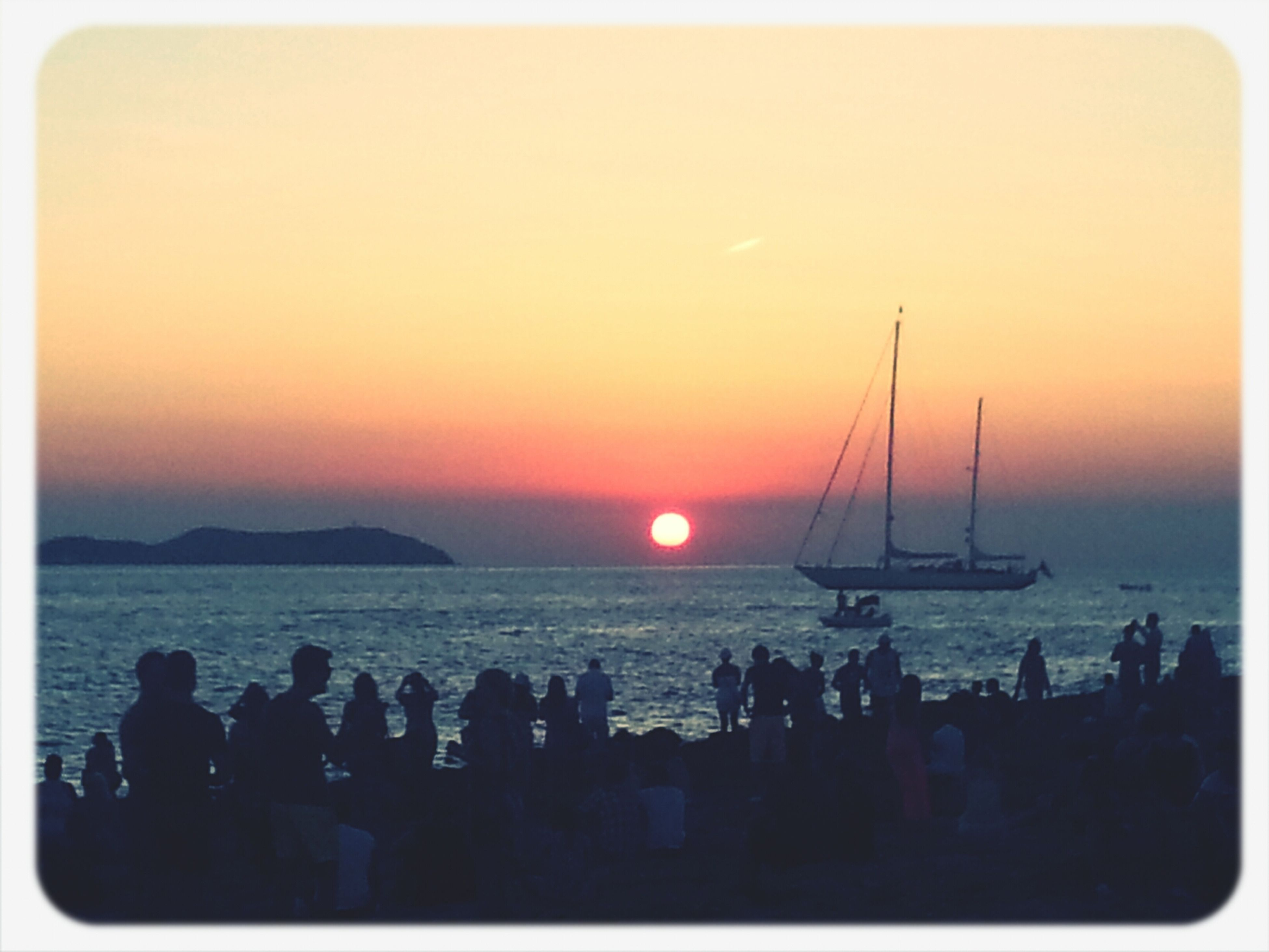 sunset, sea, horizon over water, water, transfer print, sun, transportation, nautical vessel, orange color, scenics, silhouette, boat, mode of transport, auto post production filter, beauty in nature, tranquil scene, beach, tranquility, sky, idyllic