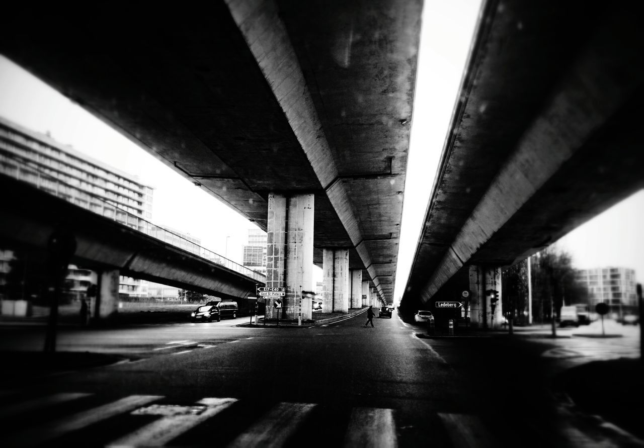 bridge - man made structure, connection, transportation, engineering, architecture, built structure, below, elevated road, underneath, road, architectural column, diminishing perspective, overpass, highway, car, city, bridge, city life, under, land vehicle, day, no people, outdoors, girder