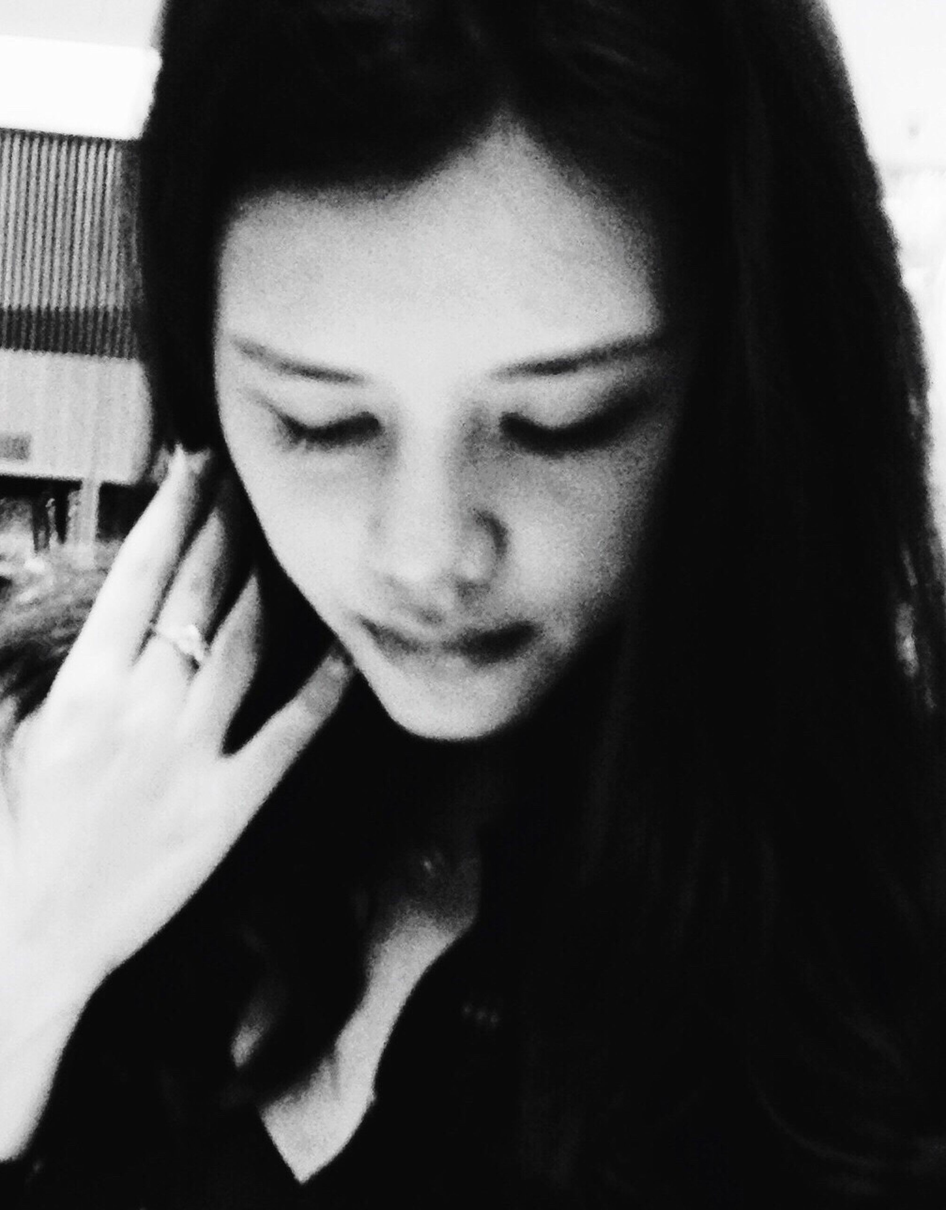 young adult, headshot, young women, indoors, person, looking down, close-up, front view, casual clothing, long hair, contemplation, human face, focus on foreground