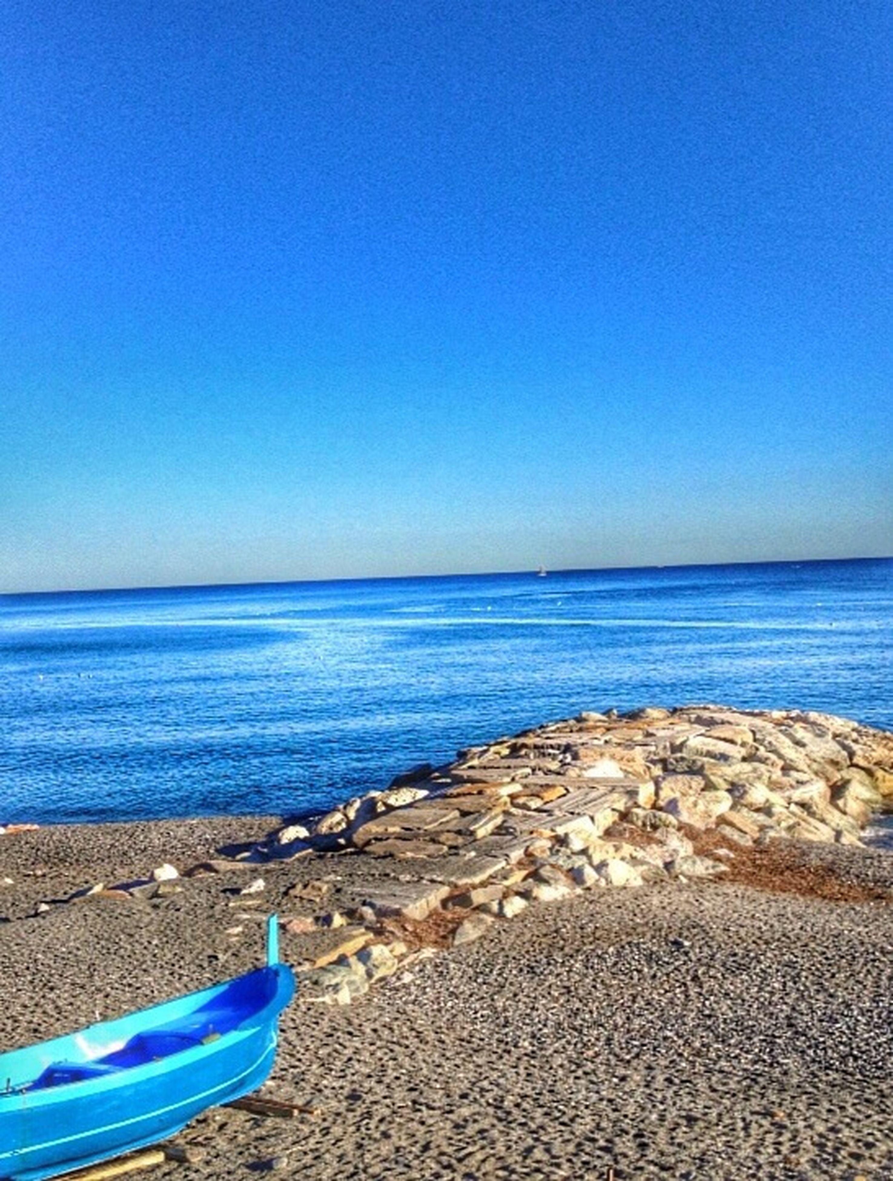 sea, blue, clear sky, beach, copy space, water, horizon over water, tranquil scene, tranquility, shore, sand, scenics, beauty in nature, nature, idyllic, day, vacations, seascape, outdoors, calm
