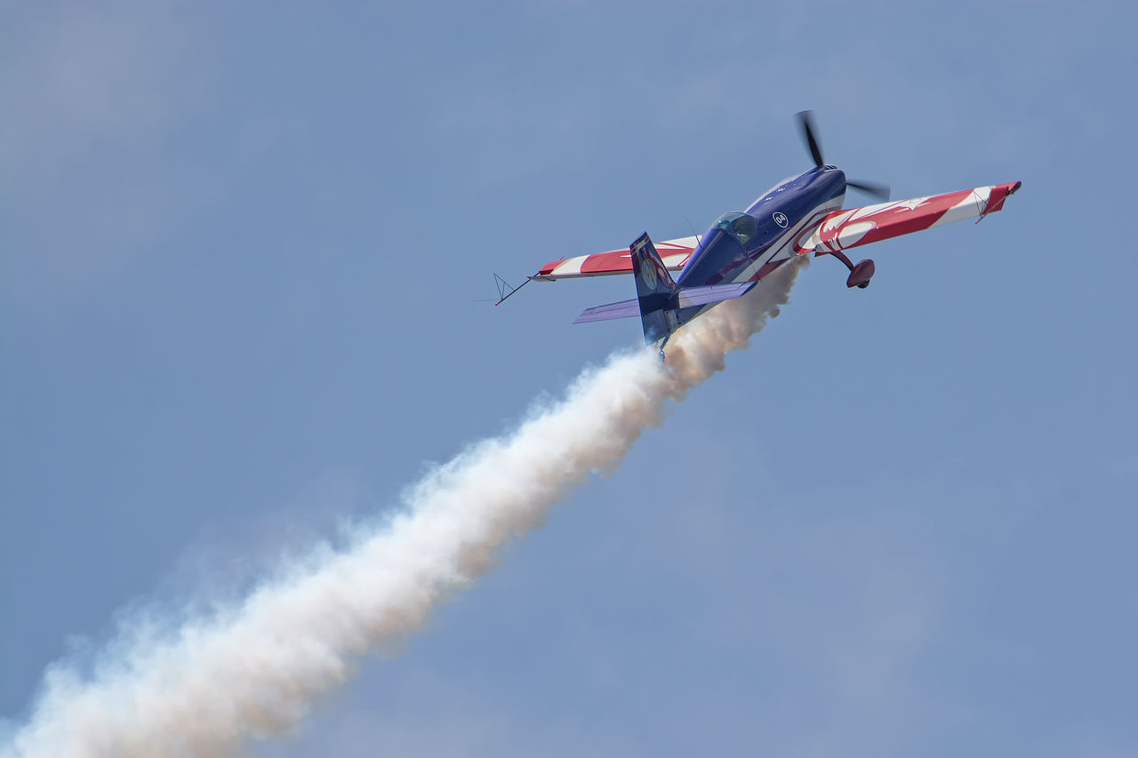 Aircraft Airplane Airshow Airshow Avion Blue Cloud Cloud - Sky Day Extra EA-330SC Fighter Plane Flying France Low Angle View Mid-air Military Airplane Mode Of Transport Motion Nature No People Outdoors Show Sky Smoke Smoke - Physical Structure