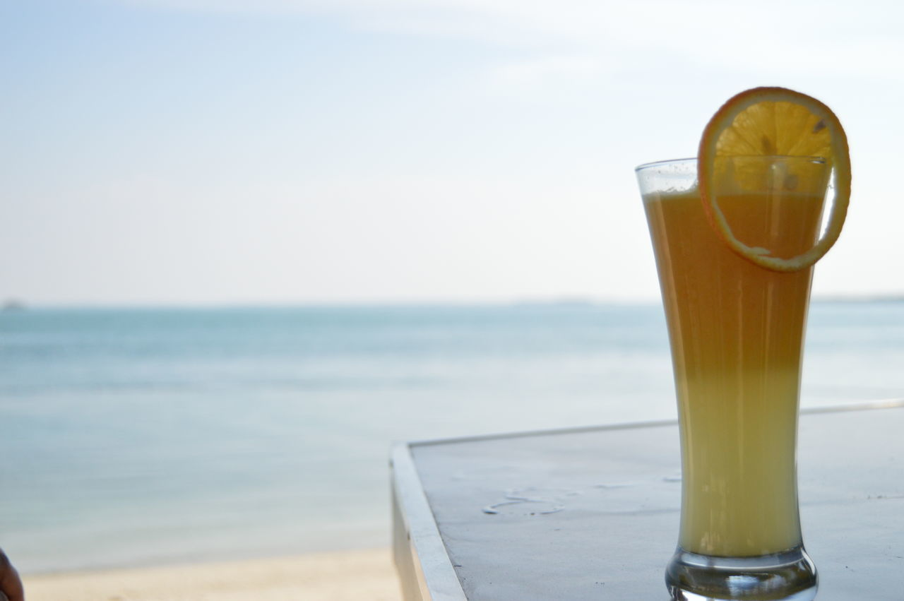 Peace Beauty In Nature Close-up Food And Drink Freshness Horizon Over Water Refreshment Sea Sky Tranquility Vacations Water