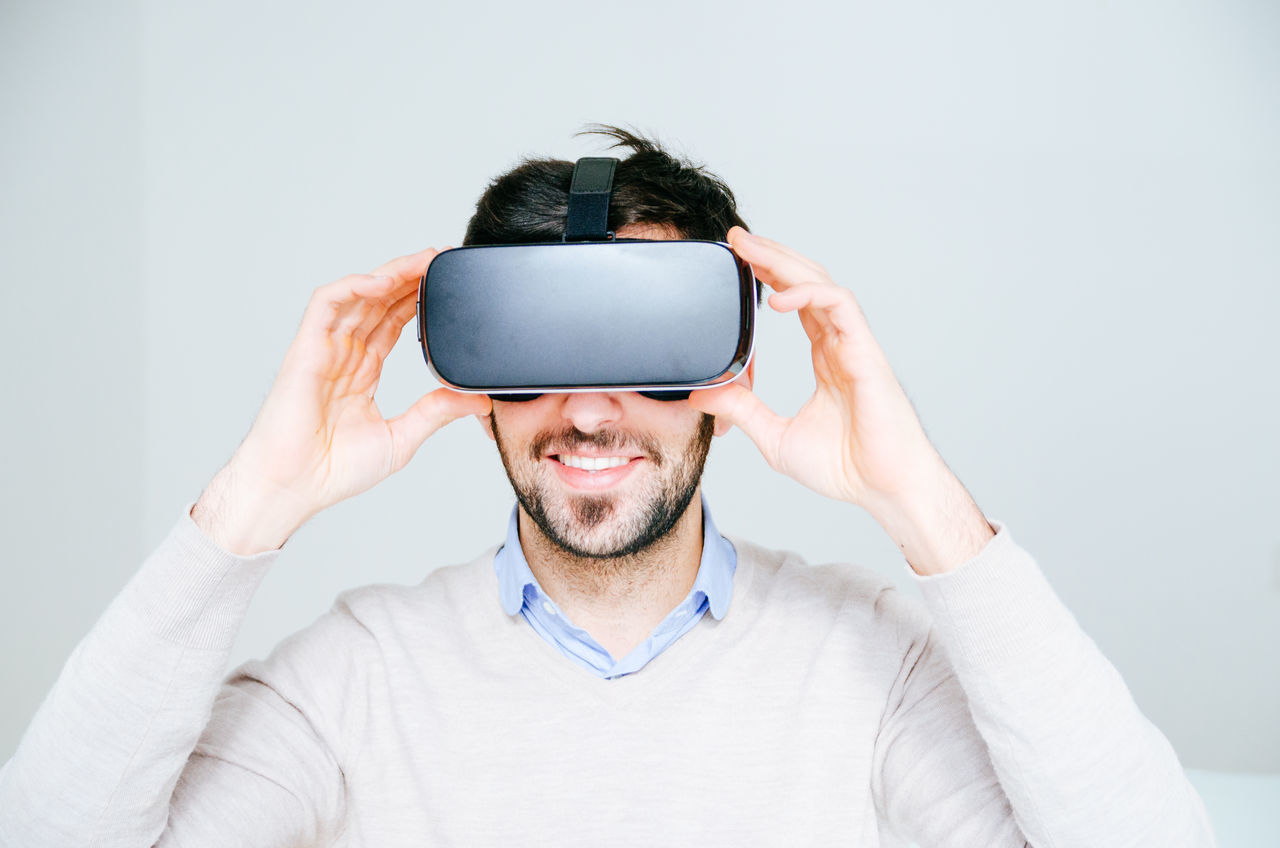 3-d Glasses Adult Adults Only Cyberspace Futuristic Human Body Part Indoors  Innovation Interactivity Looking Men Mid Adult One Man Only One Person Only Men People Smiling Studio Shot Technology Virtual Reality Virtual Reality Simulator Vr Wearable Computer Wireless Technology