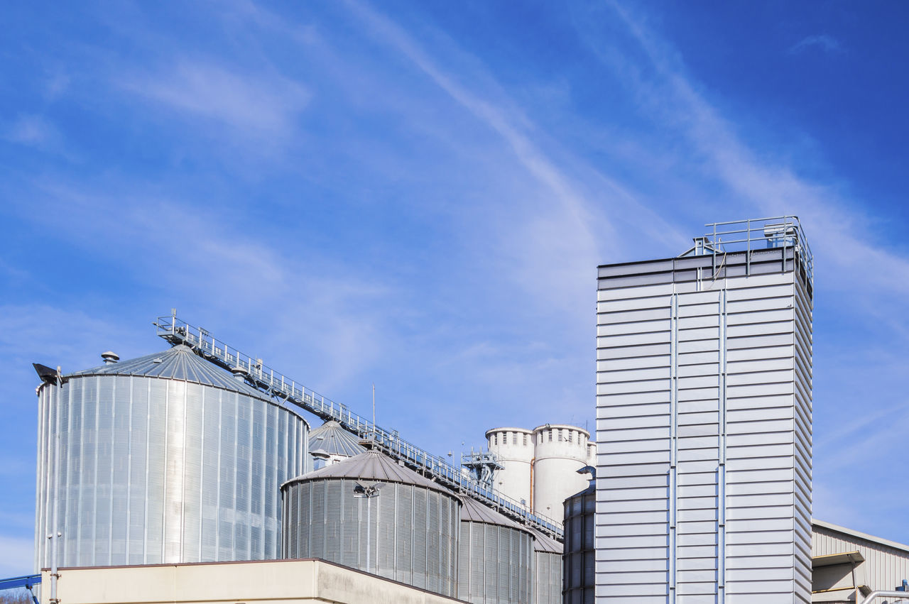 silos and drying towers Blue Building Building Exterior Built Structure City Cloud Cloud - Sky Day Development Exterior Factory Silo High Section Low Angle View Modern Nature No People Outdoors Sky Tall - High Tank