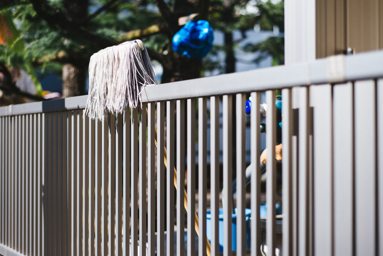 Someone got tired of cleaning... Blue Clean Cleaning My Account At EyeEm Cleaning Time, Cleaninhouse Close-up Day Fence Focus On Foreground Hanging Metal Möp No People Outdoors Pattern Selective Focus Tired Of Cleaning