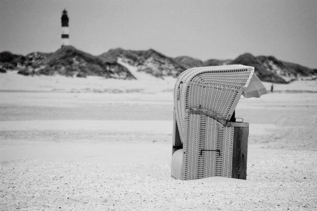 Amrum Tranquil Scene Tranquility Solitude Sky Shore Outdoors No People Nature Majestic Loneliness Day Black And White Photography Beauty In Nature Empty Travel Destinations Idyllic Beach Dune Lighthouse Beachchair