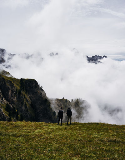 Atmosphere Beauty In Nature Cloud - Sky Day Dolomites Italy Field Fog Grass Landscape Leisure Activity Lifestyles Men Moody Sky Mountain Nature Outdoors Physical Geography Real People Scenics Sky Standing Steam Togetherness Tranquility Two People
