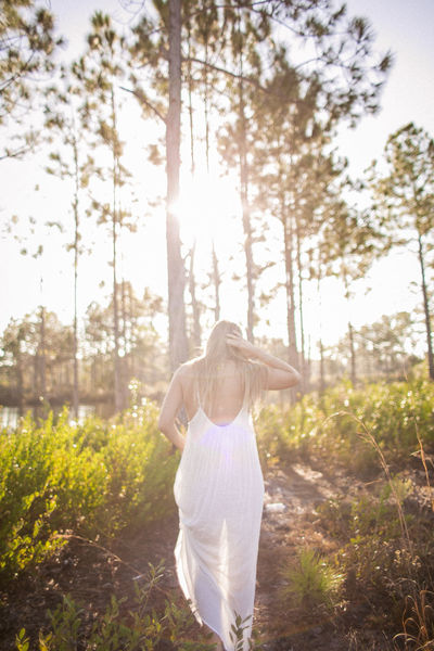 Ty in Florida in January Adult Adults Only Back Lit Day Freedom Grass Healthy Lifestyle Lens Flare Nature One Person One Woman Only One Young Woman Only Only Women Outdoors People Relaxation Simple Living Standing Summer Sun Sunlight Three Quarter Length Wellbeing Women Young Adult