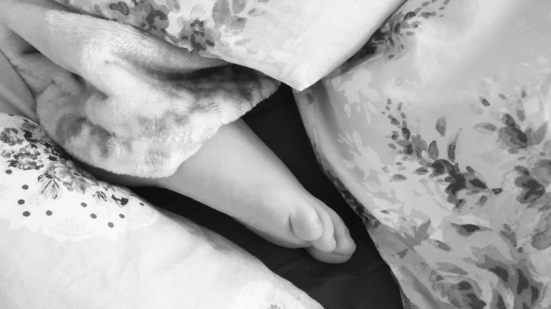 Indoors  Close-up Good Morning Warmth Cozy Cozy Place Relaxing Lazy Day Bed Blankets Flower Design Foot Human Body Part Monochrome Blackandwhite Photography Samsungphotography Leisure Activity Home Sweet Home Resting