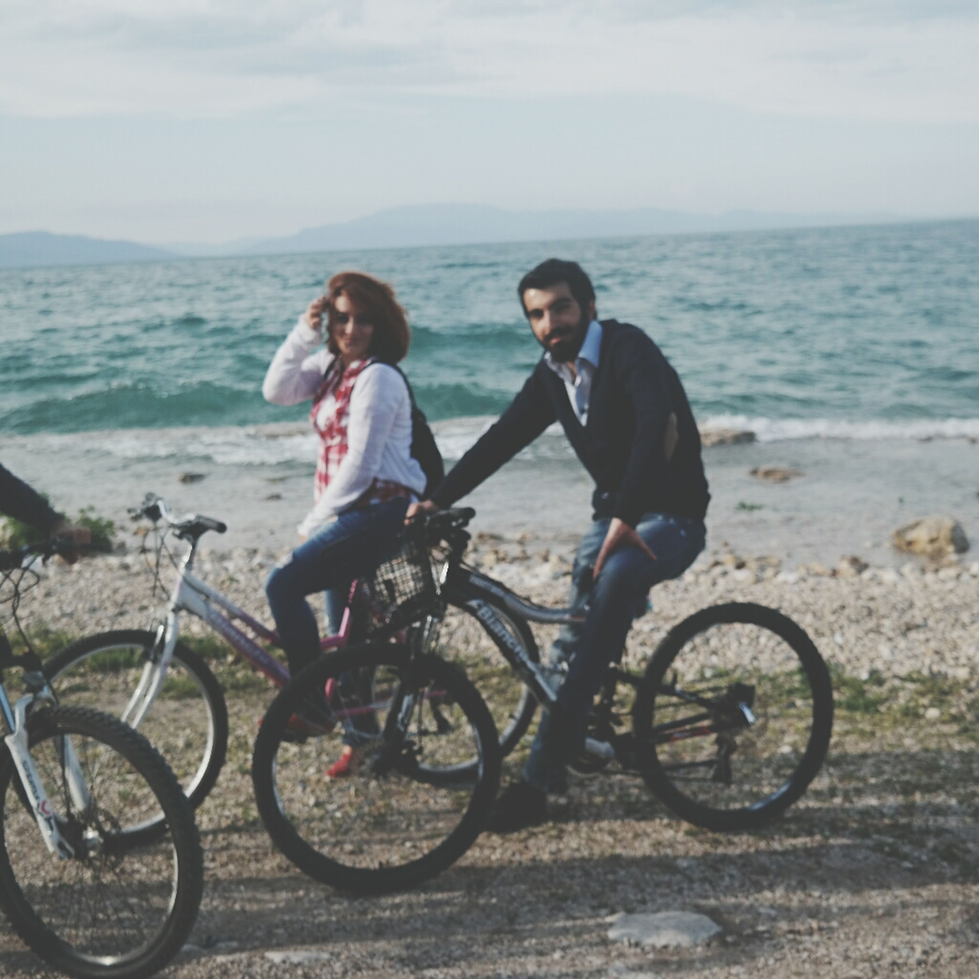 bicycle, sea, lifestyles, beach, leisure activity, full length, sky, water, mode of transport, casual clothing, transportation, shore, person, horizon over water, land vehicle, young adult, travel, sand