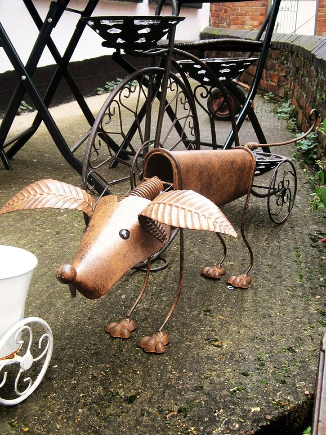 Walking Around and spotted this little dude.....he stayed still unlike most of the dogs I try Taking Photos of! :) Rusty Doggy Dogoftheday Urban Gardening Garden Sculpture  Learn & Shoot: Layering Nodding Dog Urban Sculpture Metal Sculpture