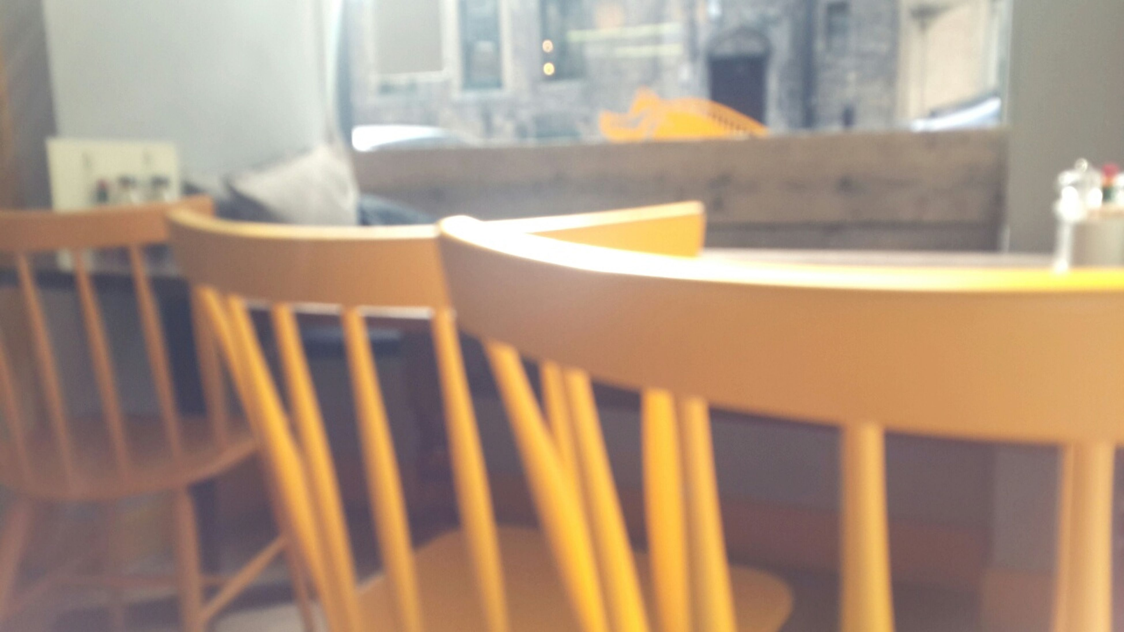 indoors, table, chair, still life, close-up, focus on foreground, selective focus, empty, home interior, absence, in a row, no people, restaurant, wood - material, arrangement, furniture, book, yellow, day, window