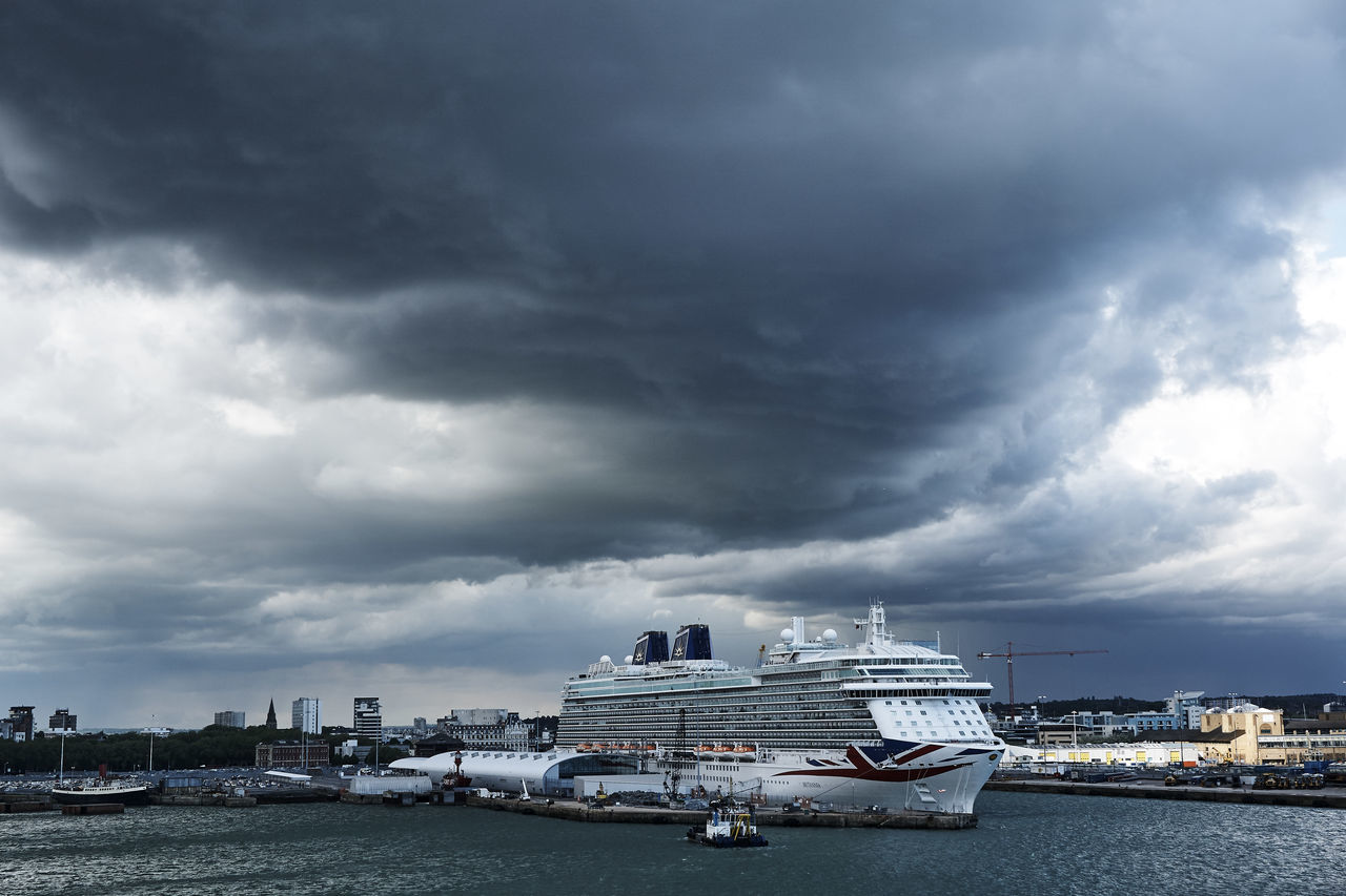 Britannia in Southampton Docks Architecture Boat Built Structure City Cityscape Cloud - Sky Cruise Ship Day Ferry Freight Transportation Harbor Mode Of Transport Moored Nautical Vessel P&O Britannia Passenger Craft Sea Ship Sky Southampton Docks Storm Cloud Transportation Water Waterfront