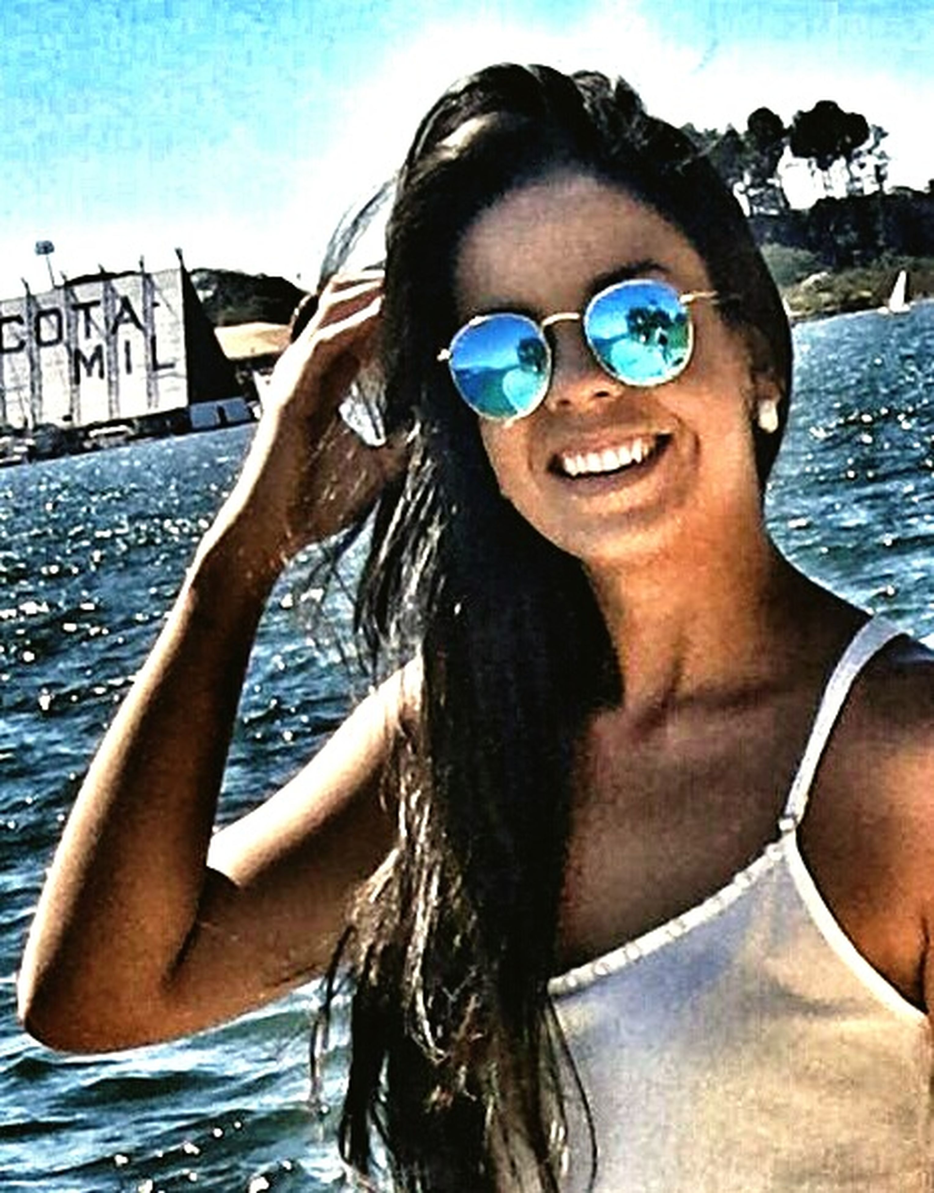 young adult, sunglasses, person, portrait, looking at camera, lifestyles, leisure activity, young women, sea, water, front view, headshot, vacations, transportation, beach, smiling, sunlight